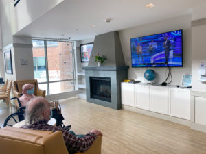 Common area with residents watching television